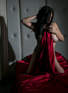Kate in red satin sheets