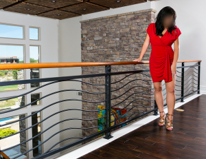 Kate red dress on balcony