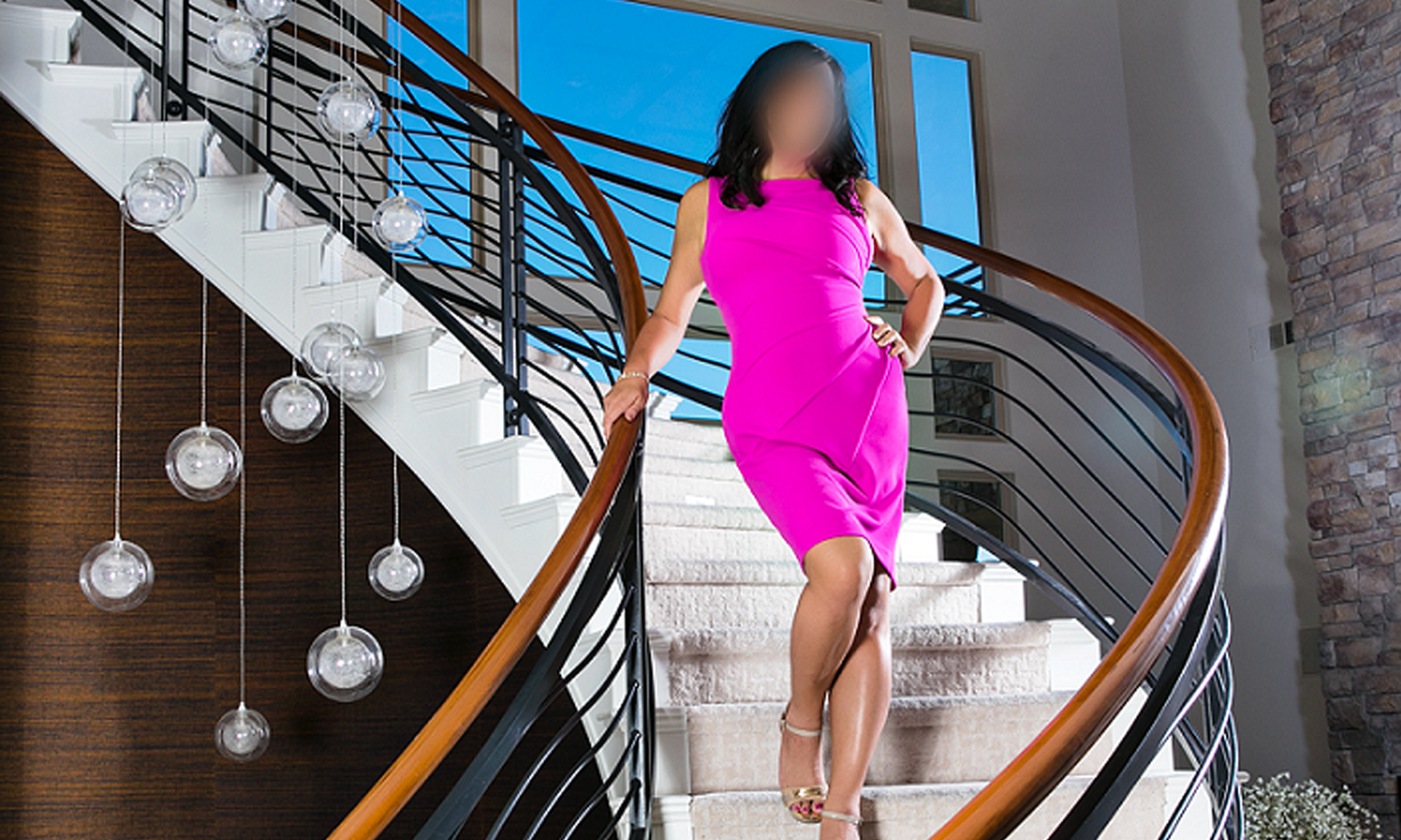 Kate in pink dress on stairs